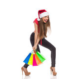 背景圣诞节女孩愉快的销售额购物白色 库存图片