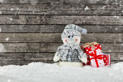 背景圣诞节礼品雪人 图库摄影