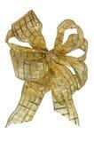 背景在空白黄色的弓圣诞节 库存图片