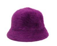 背景在紫罗兰色白色的帽子夫人 免版税库存照片