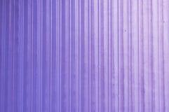 背景在紫色塑料的纹理渐进性 免版税库存图片