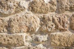 背景多孔石结构,一个古老石墙的片段在贾法角,以色列 库存照片