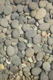 背景小卵石流纹理 免版税图库摄影