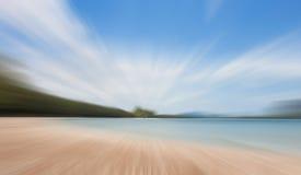 背景峡湾光芒海运星期日 这由照相机blured 库存图片