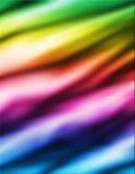 背景布料五颜六色的彩虹缎柔滑波浪 库存图片