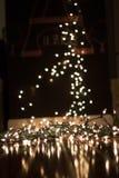 背景弄脏了在地板上的圣诞灯画象的 免版税库存照片