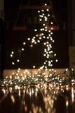 背景弄脏了在地板上的圣诞灯画象的 免版税库存图片