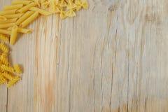 背景意大利面食原始的纹理木头 免版税库存图片