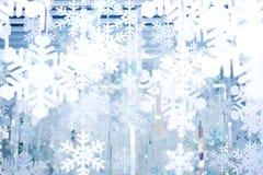 背景或纹理的白色和蓝色雪花 免版税库存图片