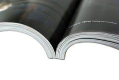 背景接近的杂志被打开的白色 免版税库存照片