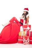 背景摆在圣诞老人性感的白色的克劳&# 库存照片