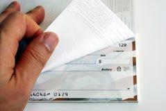 背景支票簿轻碰白色 库存照片