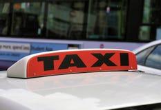 背景是象可能签署出租汽车使用 免版税库存照片