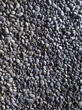 背景有启发性岩石向星期日扔石头 免版税图库摄影
