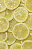 背景柑橘成熟水多的切片橙色柠檬 免版税库存图片