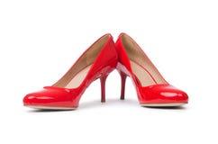 背景查出的红色穿上鞋子白人妇女 库存照片
