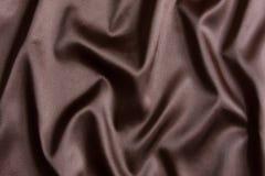 背景棕色丝绸纺织品 免版税库存照片