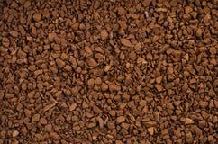 背景棕色咖啡粒子即时许多 免版税库存照片