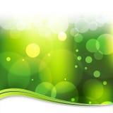 背景模糊的绿灯 免版税库存图片