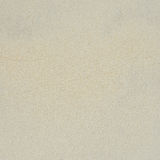 背景海滩沙子射击纹理 粗糙的沙子特写镜头  免版税库存照片
