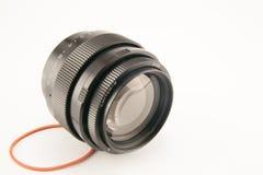 背景照相机前面查出的透镜视图白色 库存图片