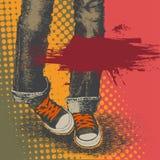 背景牛仔裤运动鞋 免版税库存照片