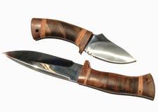 背景狩猎knifes放置二白色 库存照片