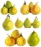 背景玻璃梨s基体白色 在背景的水多的鲜绿色和黄色梨 库存图片
