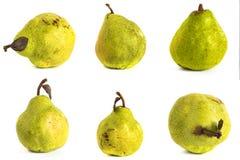 背景玻璃梨s基体白色 在被隔绝的背景的水多的鲜绿色和黄色梨 库存图片