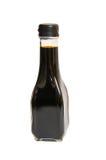 背景瓶查出的调味汁大豆白色 库存照片