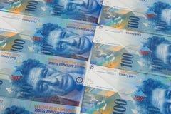 背景由100瑞士法郎制成 免版税库存照片