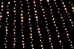 背景电灯泡圣诞节defocused图象光 库存照片