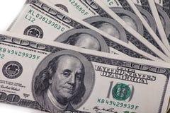 背景的一百元钞票 库存照片