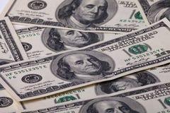 背景的一百元钞票 免版税库存照片