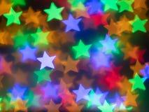 背景的五颜六色的星bokeh 免版税图库摄影