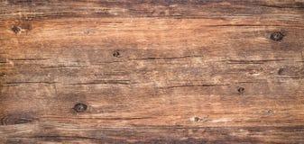 背景的布朗土气粗砺的木头 免版税库存照片