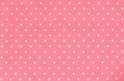 桃红色圆点织品 免版税库存照片