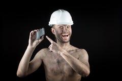 黑背景的煤矿工人 库存图片