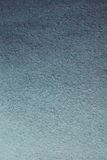 背景的纹理蓝色涂灰泥的墙壁 免版税库存照片