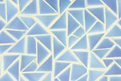 背景的蓝色马赛克墙壁 库存图片