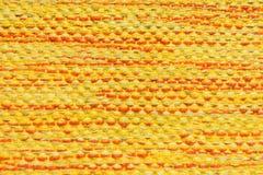 背景的黄色织品纹理 库存图片