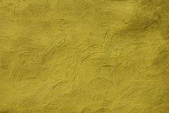 背景的黄色粒状墙壁表面纹理 图库摄影