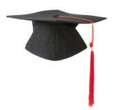 背景盖帽毕业查出的白色 免版税库存照片