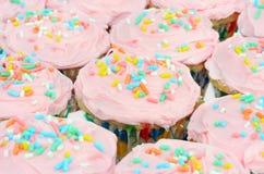 背景相当杯形蛋糕粉红色 免版税库存图片