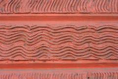 背景石墙波浪 墙壁砖红色 免版税库存照片