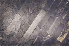 背景砖灰色纹理墙壁 仿造设计书刊上的图片的灰色板岩石头 免版税库存图片