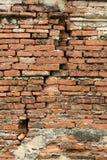 背景砖破裂的墙壁 库存图片