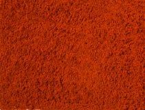 背景砖老纹理墙壁 红色辣椒粉粉末 免版税库存照片
