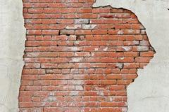 背景砖被撕毁的墙壁 库存照片