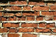 背景砖被毁坏的老墙壁 免版税图库摄影